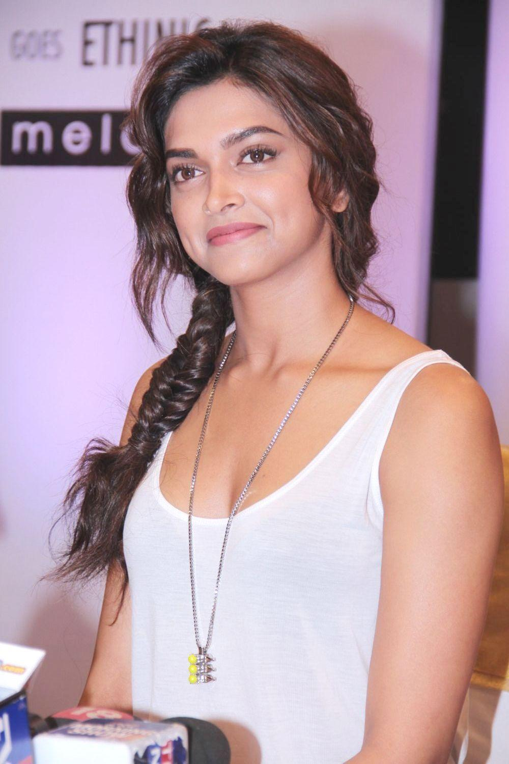 Deepika Padukone Latest Smiling Photos In White Top Red Jeans
