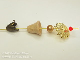 Beads and findings strung onto a head pin