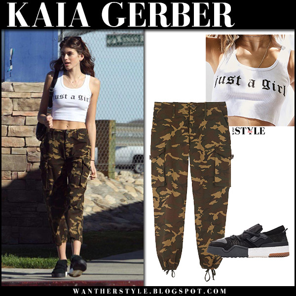 Kaia Gerber in white crop top, camo cargo pants proenza schouler pswl and black sneakers adidas model street fashion november 30