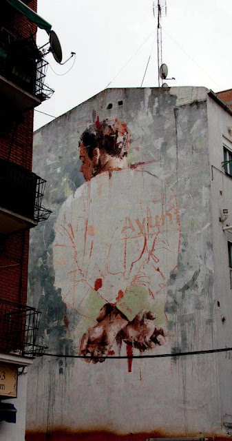 New Street Art Mural By Borondo In The District of Tetuan in Madrid, Spain. 8