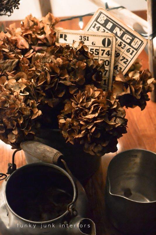 night pictures of hydrangeas and vintage bingo cards in galvanized bucket via Funky Junk Interiors