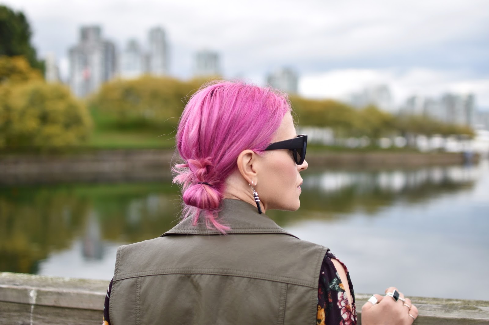 Monika Faulkner outfit inspiration - olive faux-leather moto vest, cat-eye sunglasses, fuchsia hair