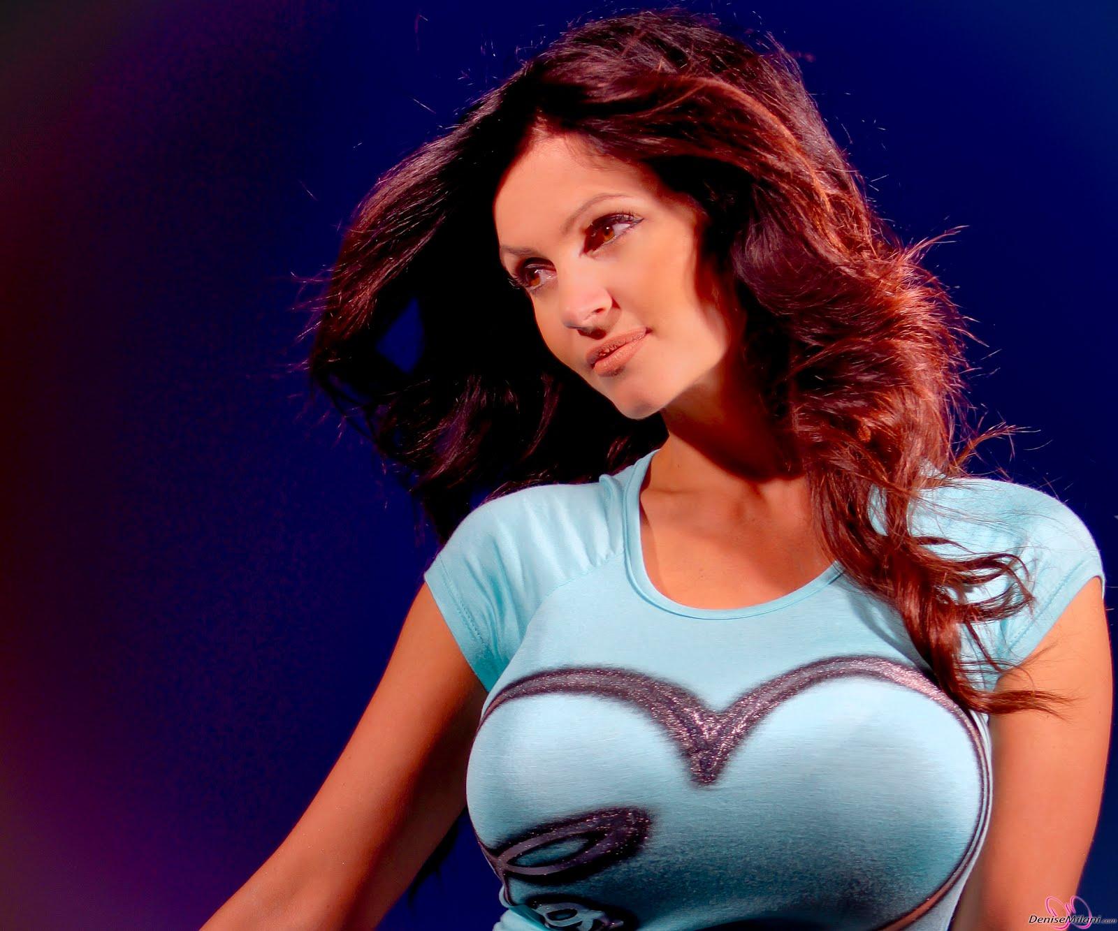 Denise Milani HD Photos In Blue Heart Dress