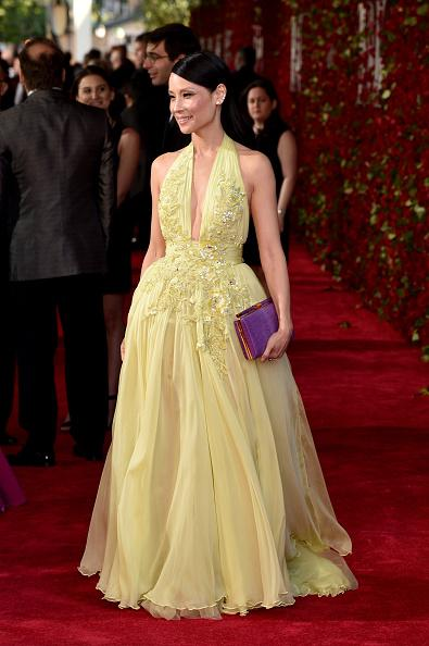 Yellow Dress, Red Carpet, Purple Clutch