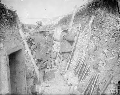 British troops fixing scaling ladders in a trench on the day previous to the opening of the Arras Offensive. Near Arras, 8 April 1917. © IWM (Q 6204) IWM Non-Commerical Licence