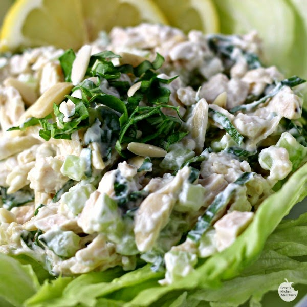 Creamy Lemon and Fresh Basil Chicken Salad by Renee's Kitchen Adventures ready to eat on a lettuce leaf.