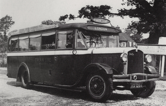 Photograph of Image 9a to source: Lewis's Cream Line Gilford coach at Mymms Drive, Brookmans Park c.1930 with the proprietor is at the wheel.