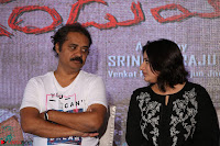 Cute Poja Gandhi in black dress at Dandupalyam 2 Movie press meet  ~  Exclusive 40.JPG
