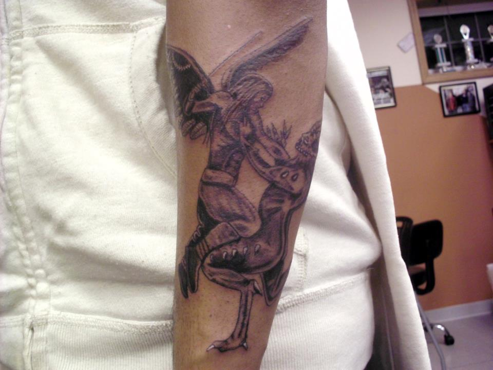 Justin Graves Tattoo Angel Fighting A Demon Sleeve