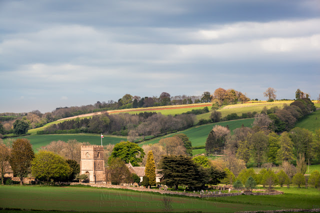 Looking towards St Michael's church at Guiting Power in the Gloucestershire Cotswolds