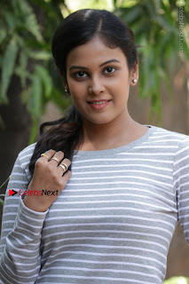 Tamil Actress Chandini Tamilarasan Latest Pos in Ripped Jeansat Ennodu Vilayadu Press Meet  0010.jpg