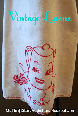 Embroidered vintage tea towel