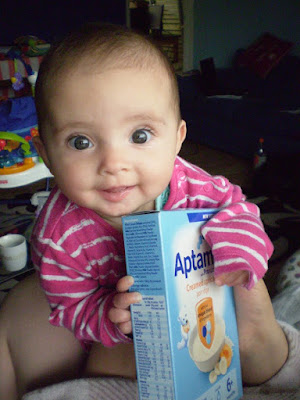 Daughter holds packet of cereal