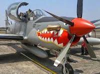 Pesawat Latih SuperTucano,Jatuh Saat Test Flight, ganti OC 10 Bronco, warna dasar loreng lukisan moncong cocor hiu warna merah