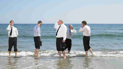 Business men on the beach