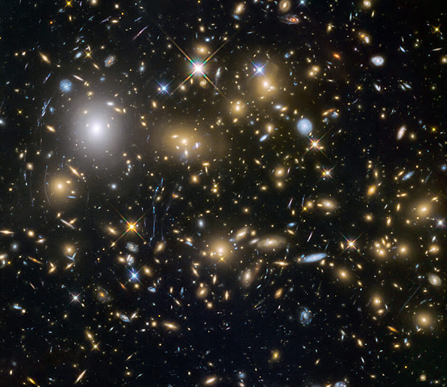 MACSJ0717.5+3745 Galaxy Cluster Imaged by the Hubble Space Telescope.
