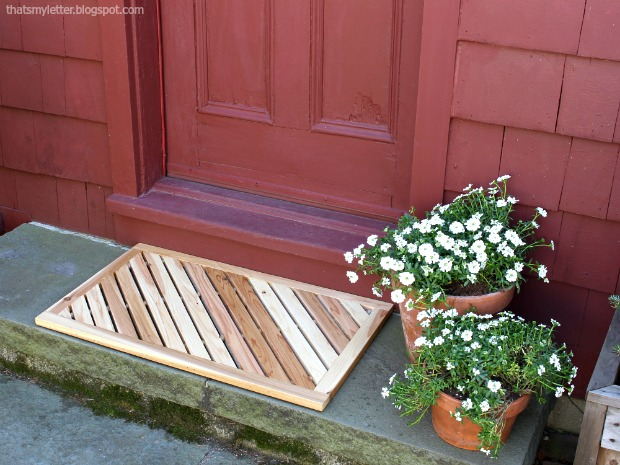 angled wooden door mat