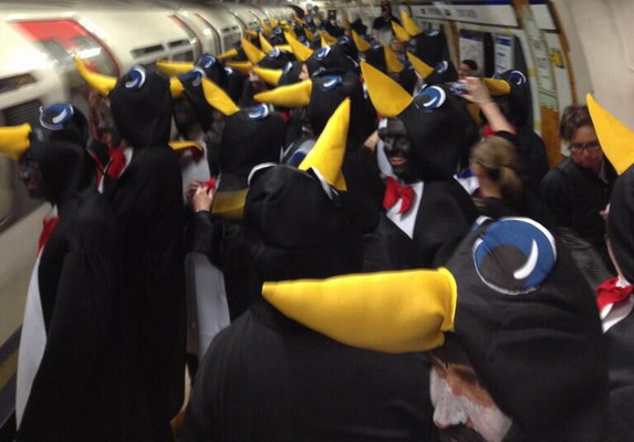 Hartlepool fans dressed up as penguins storm through the London Underground