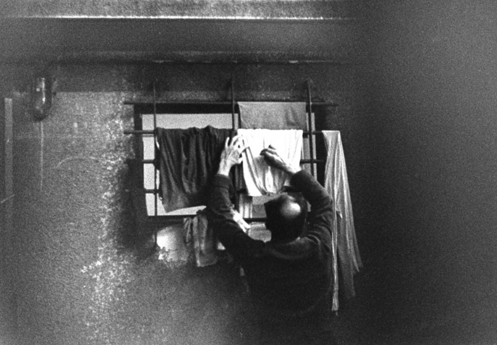 Eichmann draped shirts and underwear he had washed himself over bars of a window.