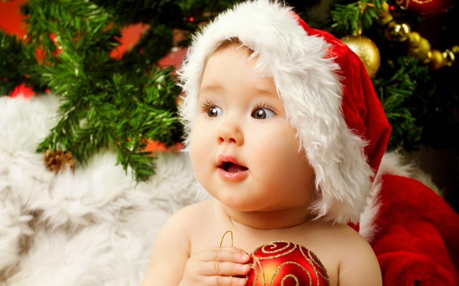 Foto bayi lucu merayakan hari natal