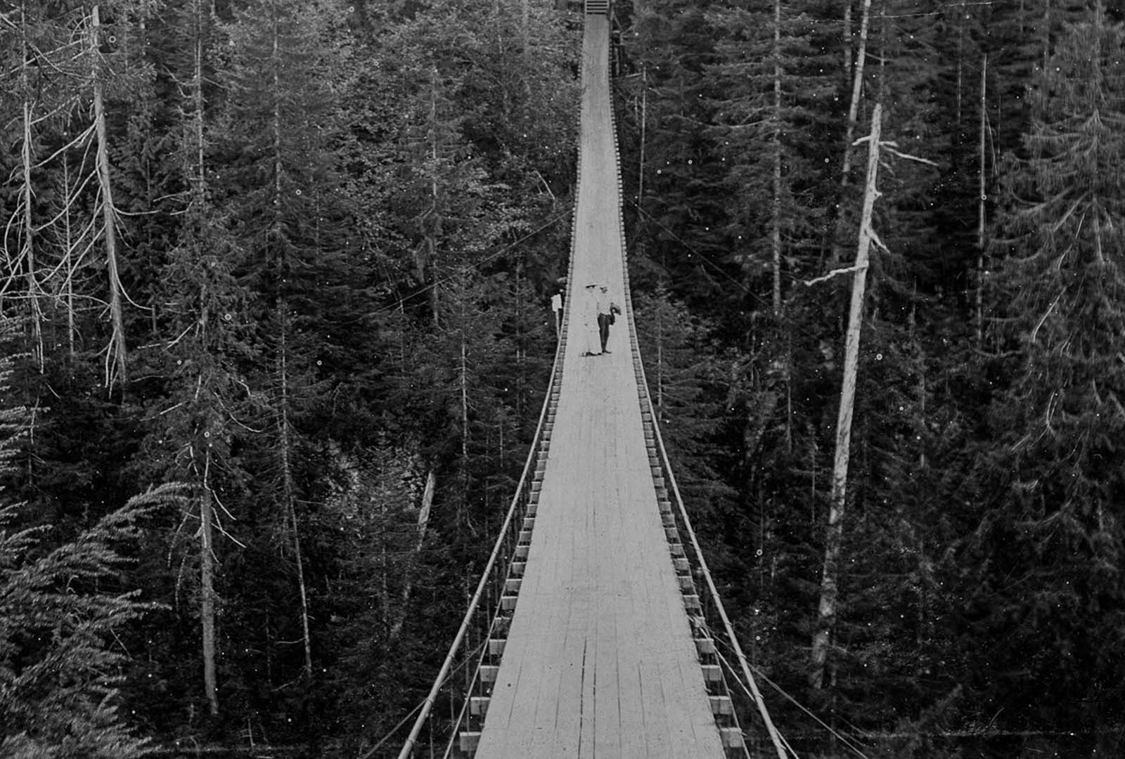 A suspension bridge over Capilano Canyon in North Vancouver. c. 1908.