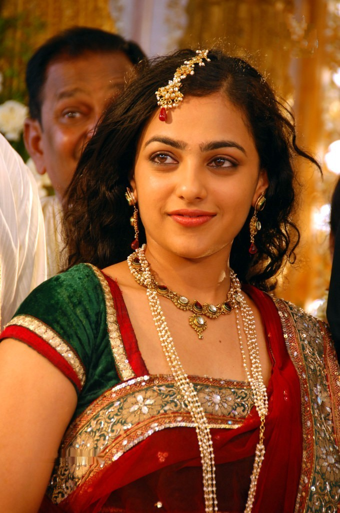 Nithya Menon Smiling Face Stills In Designer Red Saree