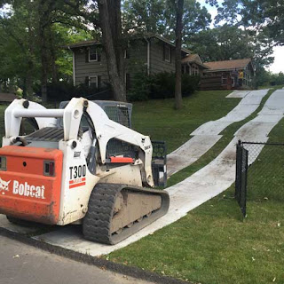 Greatmats white Ground Protection Mats skidsteer on grass