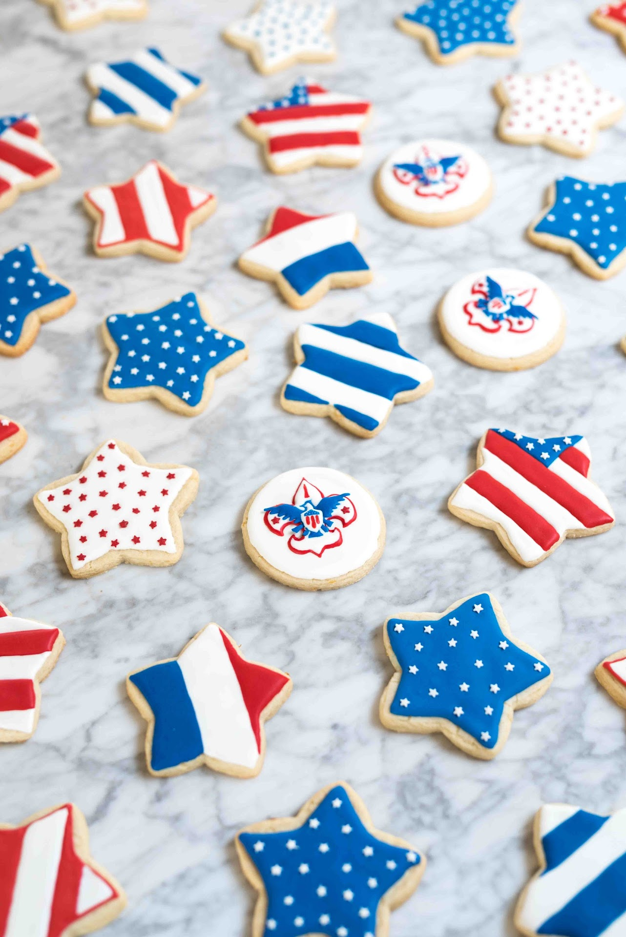 patriotic cookies, dessert, stars, cutout cookies, sugar cookies, lemon sugar cookies, best tasting sugar cookies, royal icing, tips, ideas, how to decorating sugar cookies, best royal icing, boy scout cookies, red white and blue, summer, usa, flag, star dessert, court of honor, american flag, flag cookies, 4th of july,