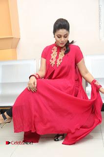Actress Poorna Latest Stills in Red Dress at Rakshasi First Look Launch  0293.JPG