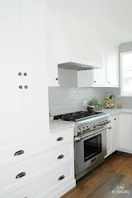 light blue tile white kitchen