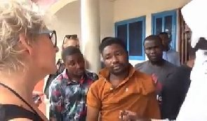 Video: White lady tracks down Ghanaian yahoo boy, gets him arrested for defrauding her of over 20,000 euros