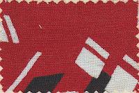 Üzerinde siyah beyaz desenler olan kenarları zikzaklı kırmızı kreşendo kumaş