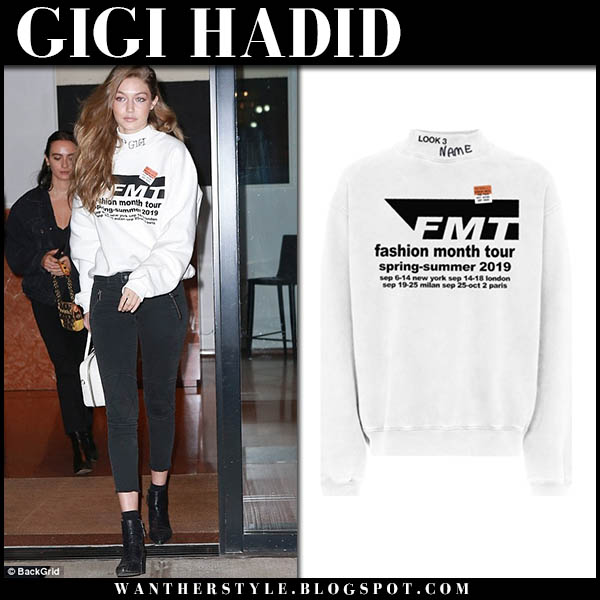 Gigi Hadid in white sweatshirt, skinny jeans with white bag prada model street style october 5