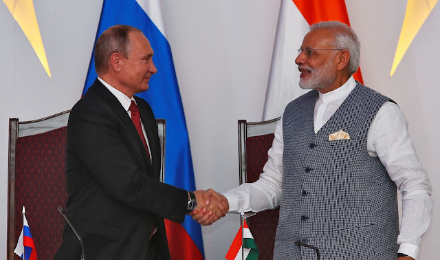 Image Attribute: Russian President Vladimir Putin (L) shakes hands with India's Prime Minister Narendra Modi during exchange of agreements event after India-Russia Annual Summit in Benaulim, in the western state of Goa, India, October 15, 2016. REUTERS/Danish Siddiqui