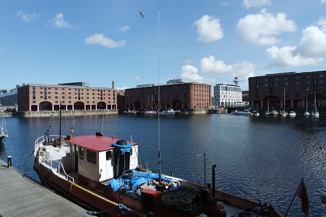 tugboat in liverpool albert docks on a beautiful sunny day
