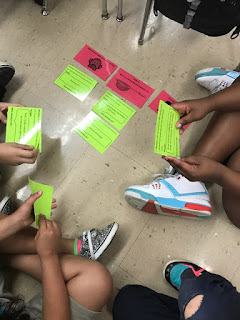 Students engaged with sorting cards related to a  lesson plan on Social Filter.