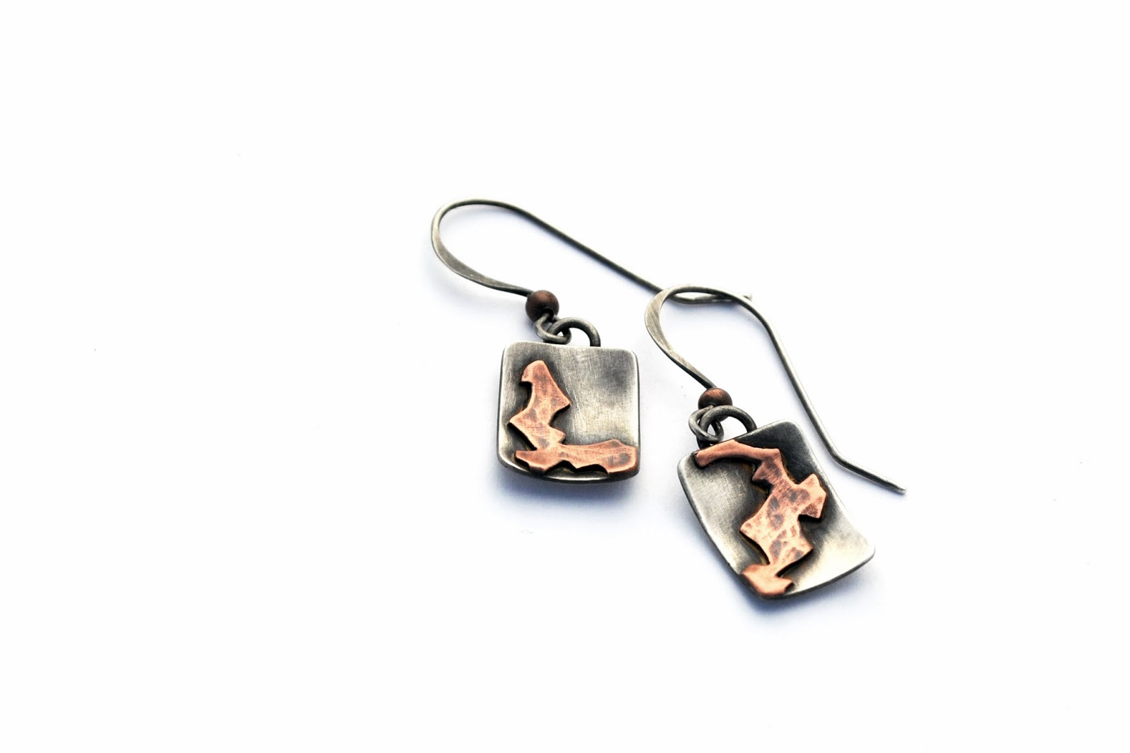 https://www.etsy.com/listing/174736692/mismatched-sterling-silver-and-copper?ref=listing-shop-header-1