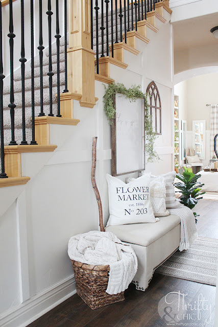 Spring entry way decor. How to decorate your stairs. Hallway decorating ideas. Spring decor and decorating ideas. Farmhouse spring decor. Easy spring decor. Entry way storage. Two story entry way with stairs.