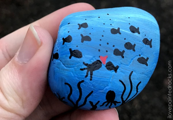 painted rock with fish and octopus