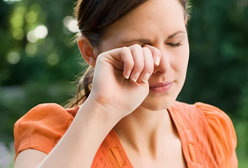 "<img alt=""young woman rubbing her dry eyes"""