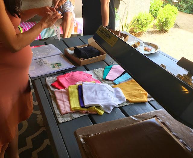 baby shower onesie decorating station, baby shower onesie station, heat transfer vinyl, baby shower, heat press