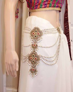 https://www.amazon.in/gp/search/ref=as_li_qf_sp_sr_il_tl?ie=UTF8&tag=fashion066e-21&keywords=kundan belly  Chain&index=aps&camp=3638&creative=24630&linkCode=xm2&linkId=b0039560c55fc66f400bcc78018ad88a