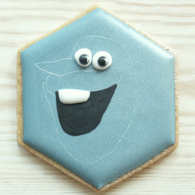Blue cookie with Olaf's mouth, eyes and teeth, photo by Honeycat Cookies