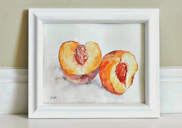 watercolor peach painting in a white frame