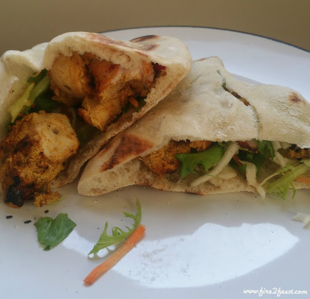 tandoori chicken stuffed into homemade pita breads