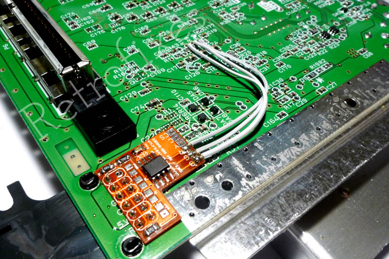 now it is time to replace the bottom metal shielding  the amp is very slim  and designed to rest beneath the edge of the shielding as seen in the photo