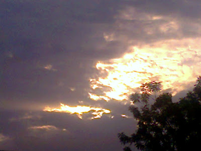 Image: Sky spreading golden light diminishing the dark