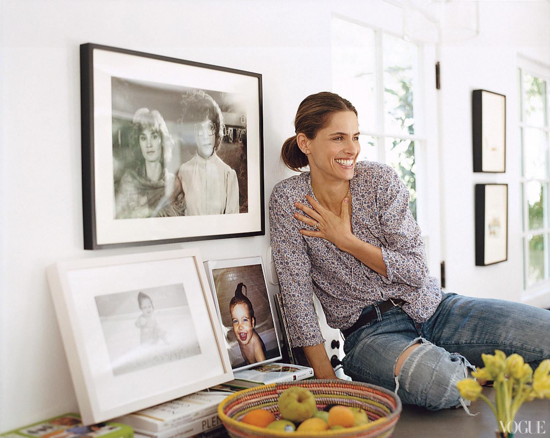 Amanda Peet at home with framed photos