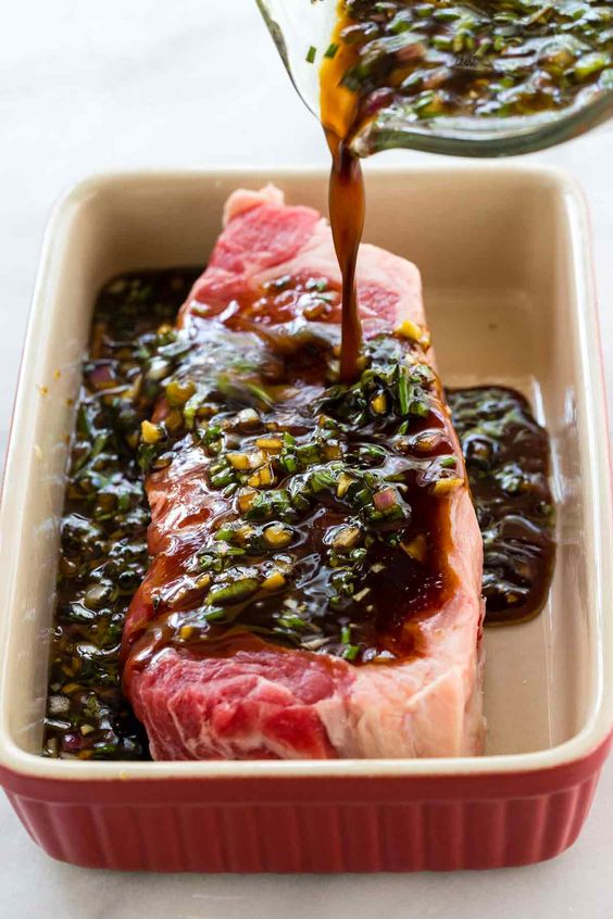 This easy steak marinade recipe is the BEST, and it will quickly add tons of flavor to any cut of beef! The mixture is a blend of soy sauce, Worcestershire sauce, onion, garlic, honey, olive oil, and fresh herbs.