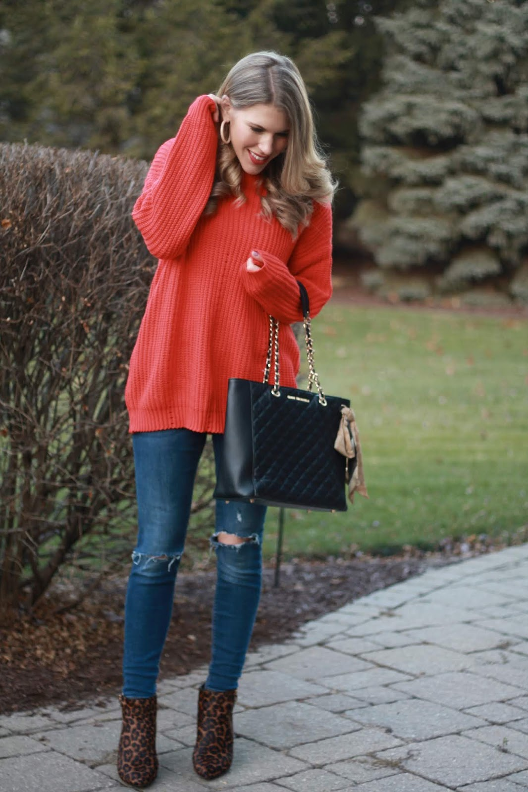 orange eyelet tunic, distressed jeans, leopard calf hair booties, tortoise shell earrings, black quilted leather tote